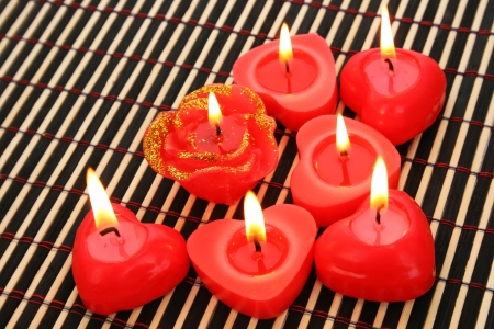 Red candles on wooden math. photo