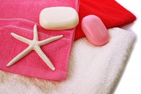 Towels with starfish, soaps horizontal closeup picture. photo