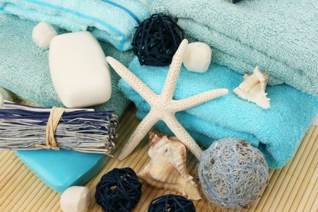 Towels and decoration on bamboo mat. photo