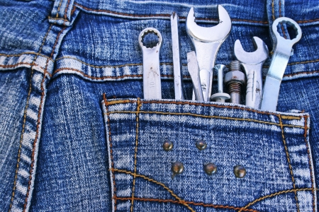 Tools set in blue jeans pocket  Stock Photo - 14110917