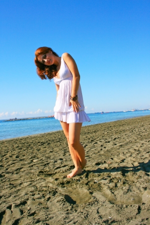 Pretty woman in white dress on beach in Limassol, Cyprus. Stock Photo - 16437184