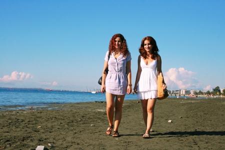 Two women on beach in Limassol, Cyprus. Stock Photo - 16437222