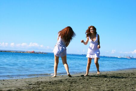 Two women on beach in Limassol, Cyprus. Stock Photo - 16521082