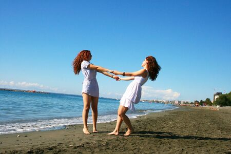 Two women on beach in Limassol, Cyprus. Stock Photo - 16763845