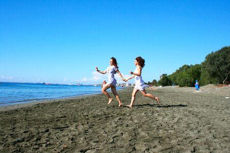 Two women on beach in Limassol, Cyprus. Stock Photo - 16826623