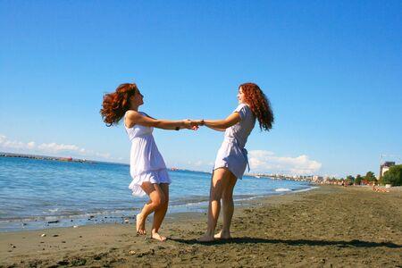 Two women on beach in Limassol, Cyprus. Stock Photo - 16882806
