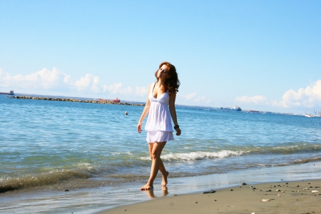 Pretty woman in white dress on beach in Limassol, Cyprus. Stock Photo - 16902437