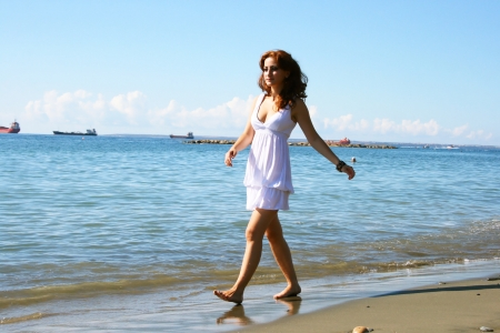 Pretty woman in white dress on beach in Limassol, Cyprus Stock Photo - 16940171