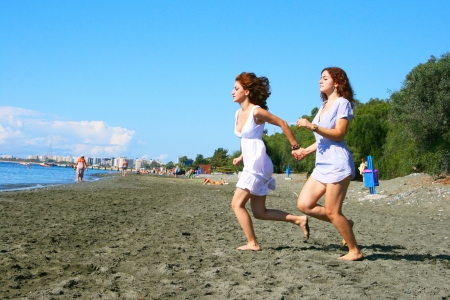 Two women on beach in Limassol, Cyprus. photo