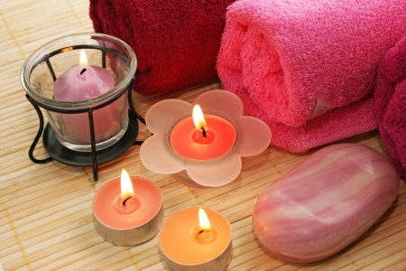 Towels, candles, soap on mat  background. photo