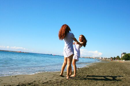 Two women on beach in Limassol, Cyprus Stock Photo - 17049861