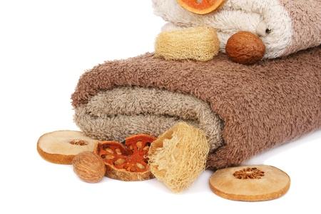 orange washcloth: Towels isolated on white background.