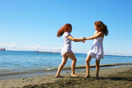 limassol: Two women on beach in Limassol, Cyprus.