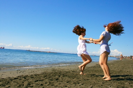 Two women on beach in Limassol, Cyprus. Stock Photo - 17193225