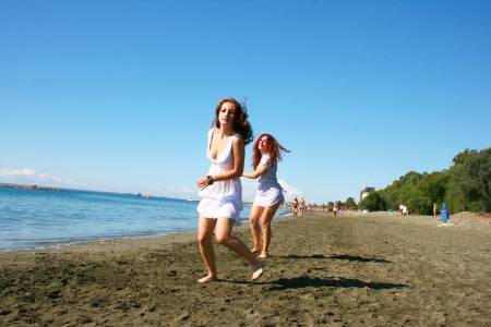 Two women on beach in Limassol, Cyprus. Stock Photo - 17210460
