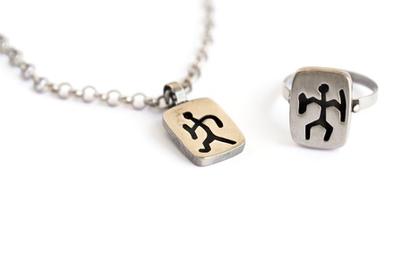 cuneiform: Silver necklace and ring with ancient Armenian pictogram isolated on white background. Stock Photo