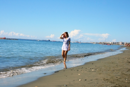 Pretty woman on beach in Limassol, Cyprus. photo