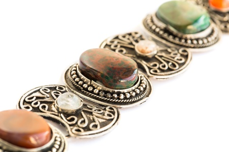 Armenian ancient style bracelet with colorful natural stone isolated on white background. photo