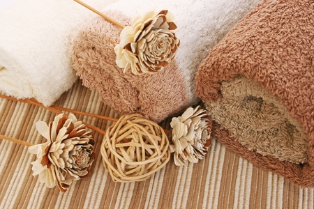 Towels and wooden decoration on mat background. Stock Photo - 17620407