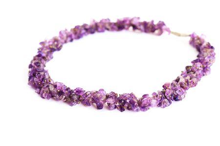 Amethyst necklace isolated on white background. photo