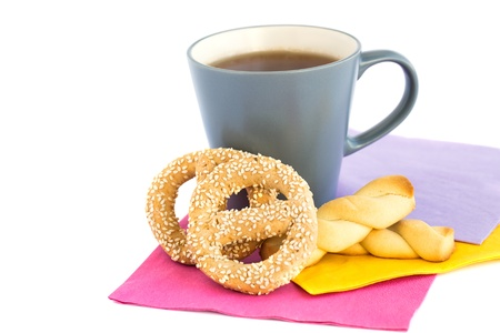 rubicund: Cup of tea, cookies  and rusks  isolated on white background.