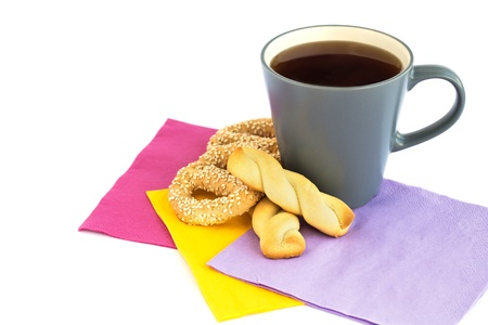 Cup of tea, cookies  and rusks  isolated on white background. photo