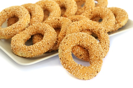sesame cracker: Round rusks with sesame seeads on tray. Stock Photo