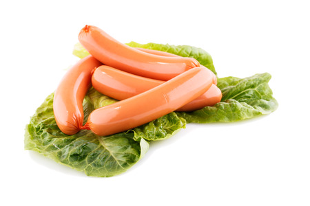 Sausages and lettuve leaves isolated on white background  photo