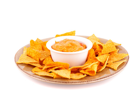 Nachos and cheese sauce isolated on white background. Standard-Bild