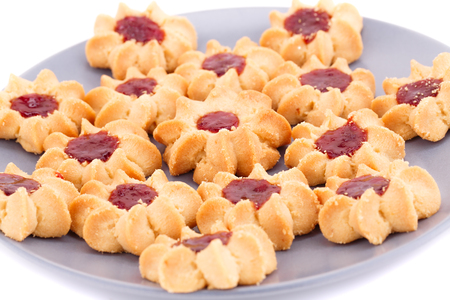 nutritiously: Sweet cookies with jam on gray plate isolated on white background.
