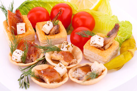 Smoked fish  and feta cheese in pastries and fresh vegetables. photo