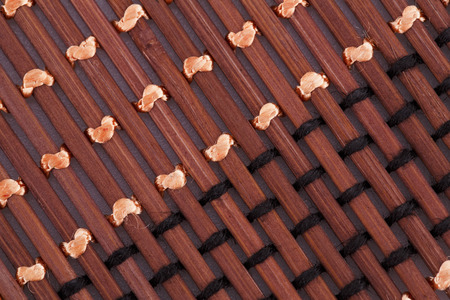 Wooden placemat texture for background, close-up image. photo