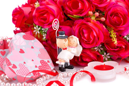fiance: Red roses, bride and fiance, candle and gift box close up picture.