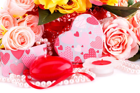 bijoux: Colorful roses, candles, beads and gift box close up picture.
