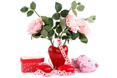 Red heart candles, roses in vase, necklace and gift boxes on white background. photo