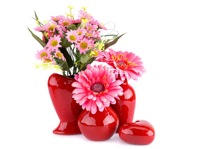 Flowers in vases and glass heart isolated on white background. photo