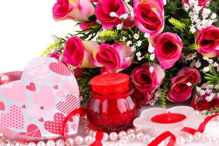 bijoux: Colorful flowers, candles and gift box close up picture.