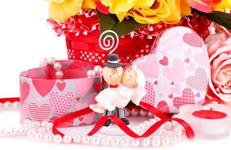 Colorful roses, bride and fiance, candle and gift box close up picture. photo