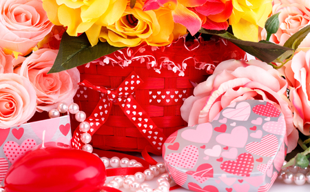 Colorful roses, candles, beads and gift box close up picture. photo