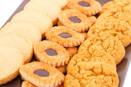 nutritiously: Sweet cookies on brown plate close up picture.