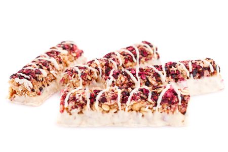 sweetie: Cereal bars with different berries and seeds isolated on white background. Stock Photo