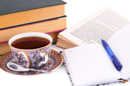 univercity: Books, cup of tea, note-pad and pen on white background.