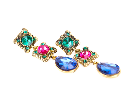 personal ornaments: Stylish earrings with colorful stones isolated on white background.