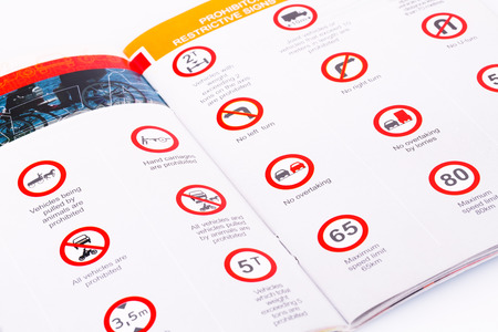 Traffic rules study book opened page with road signs. Stok Fotoğraf