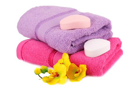 absorbent: Towels, soaps and flowers isolated on white background.