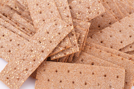 sesame cracker: Pile of crackers with sesame seeds close-up picture. Stock Photo
