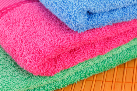 absorbent: Colorful folded towels closeup picture.