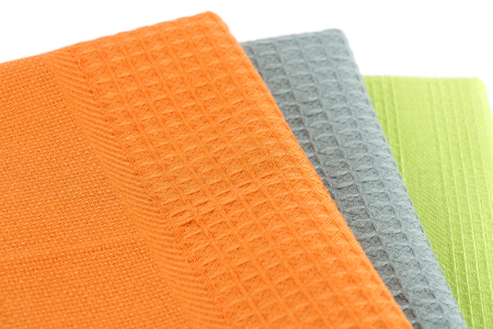 dishcloth: Stack of colorful kitchen towels on white background.