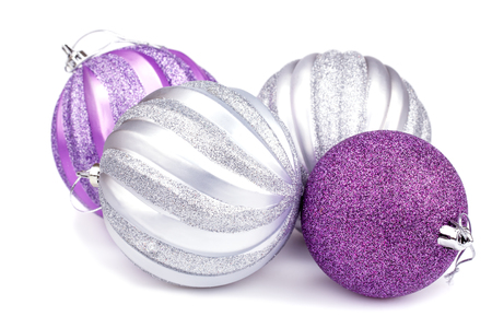 four objects: Christmas balls isolated on white background.