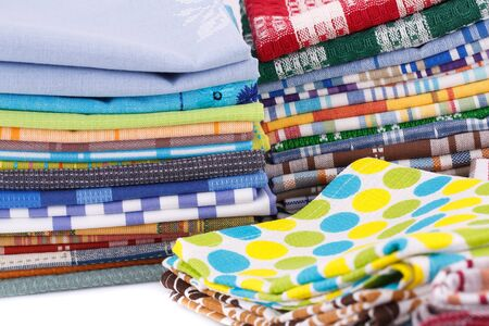 Stack of colorful kitchen towels closeup picture. Stock Photo